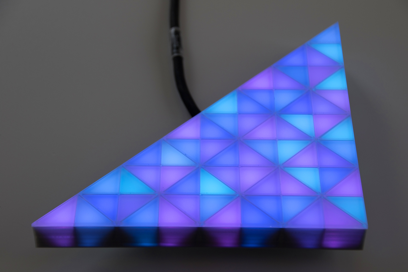 fully video capable, blue glowing LED module in a triangular shape