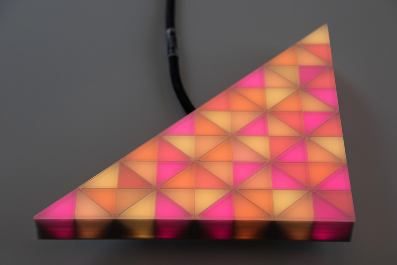 fully video capable, orange glowing LED module in a triangular shape